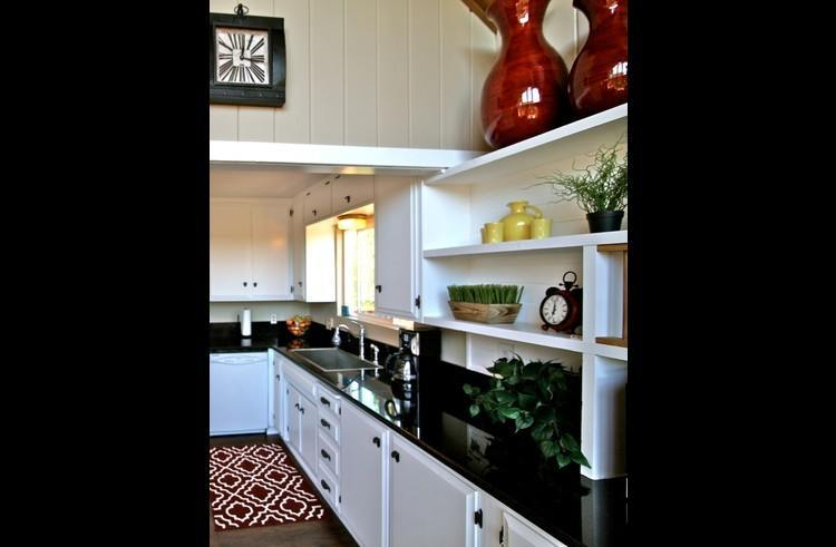 Remodeled kitchen with black granite counter tops
