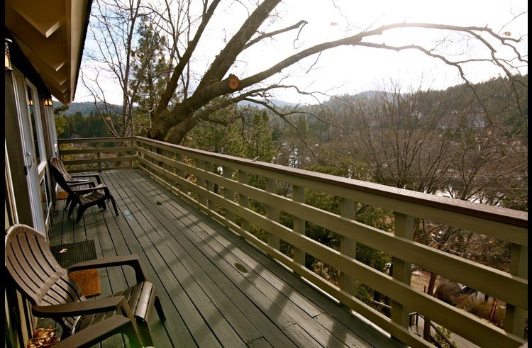 Upper level deck with adirondack chairs