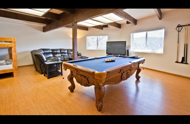 Pool table, L shaped sofa and 60