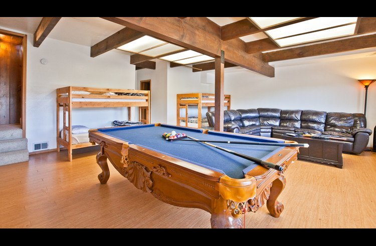 Guest room 4 on with 2 bunk beds and pool table