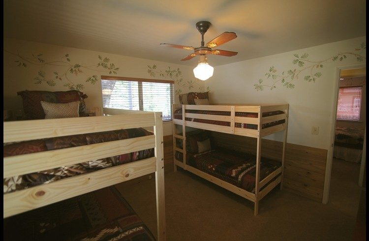 Guest room 2 on main level with two bunk beds