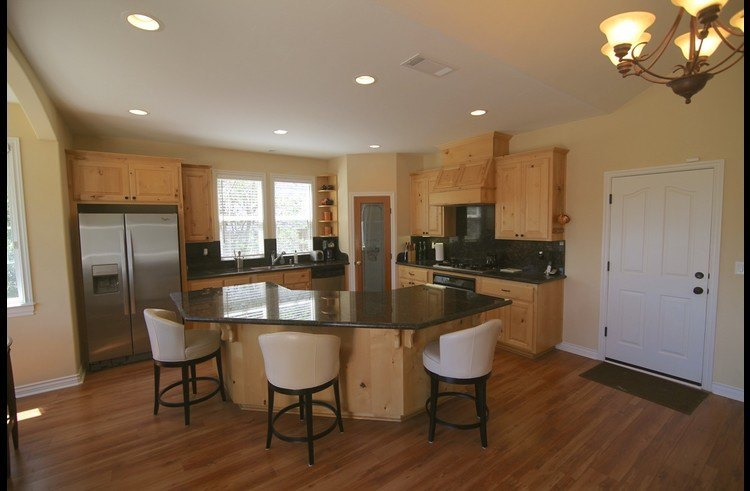 Kitchen with a large island and slab granite counter tops