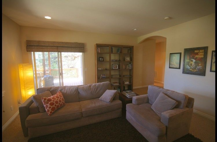 Family room with access to lower level deck