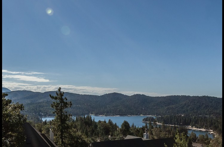 Panoramic views from the deck of Lake Arrowhead surrounded by trees