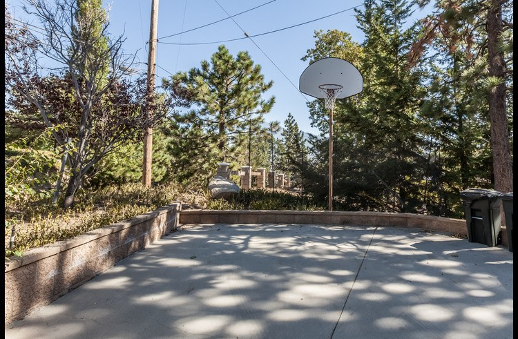 Large flat driveway with basketball hoop