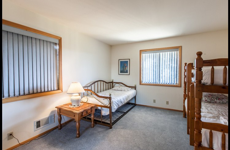 Guest room on lower level with 3 twin beds