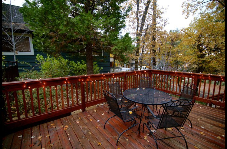 Deck on side of the home with patio furniture
