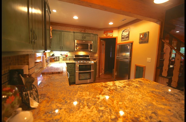 Gourmet kitchen with new stainless steel appliances