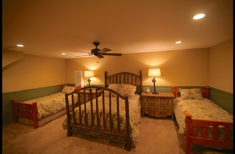 Guest room 1 on lower level with queen bed and 3 twin size beds