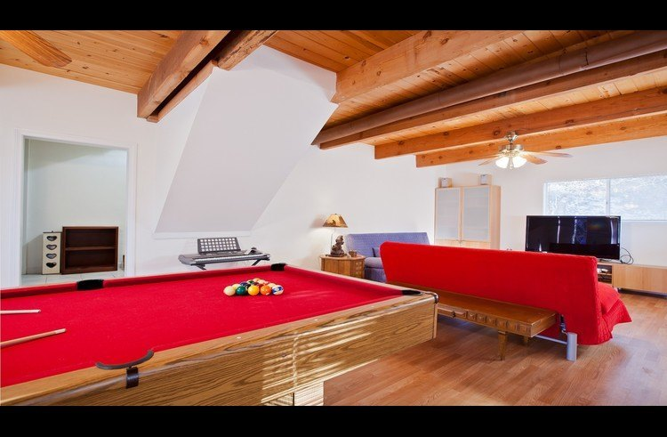 Game room with pool table and large flat screen TV