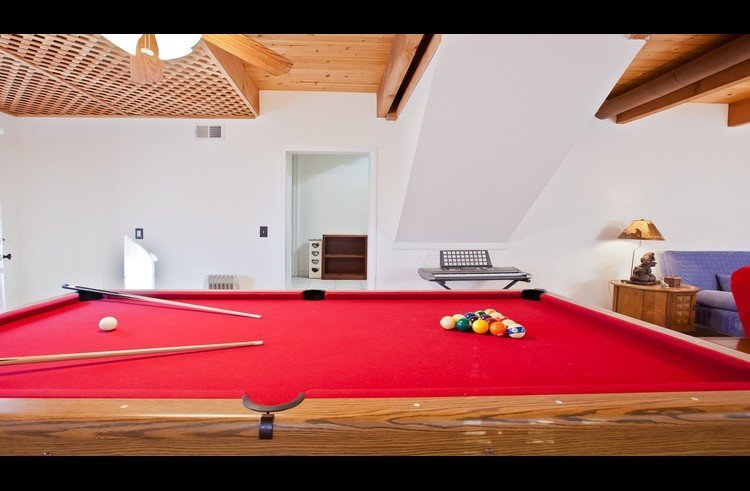 Full size pool table on lower level