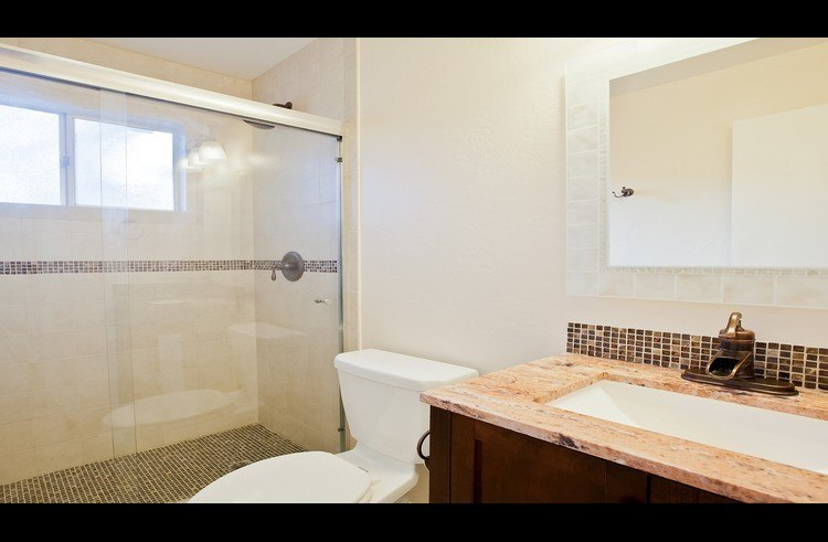Remodeled bath on main level with large shower