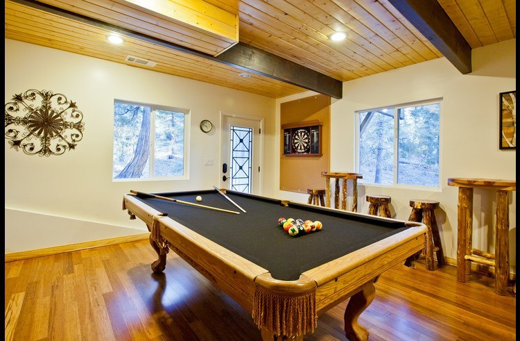 Pool table and dart board on lower level