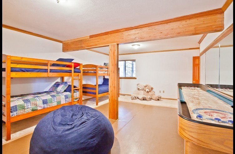 Guest room 4 with two twin size bunks and shuffle board table