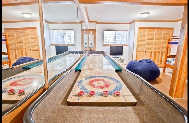 Tournament style shuffle board table and flat screen TV