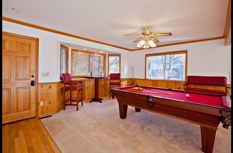 Game room with pool table on the main level