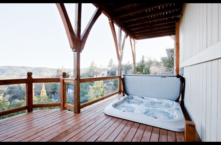 Hot tub in the lower level deck with great views of the lake
