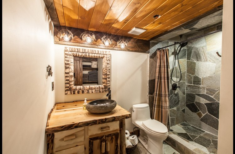 Bathroom on lower level with custom stone shower