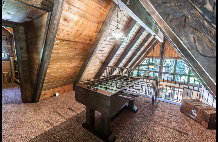 Foosball table on the upper level loft