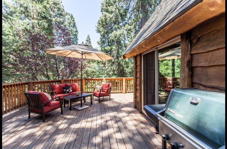 Outdoor patio furniture and BBQ on large deck
