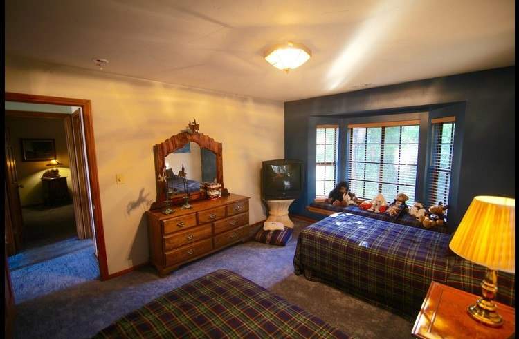 Guest room 2 on upper level with two twin size beds