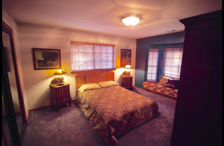 Guest room 1 on upper level with full size bed