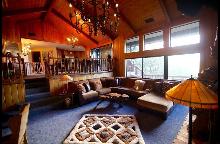 View of living room with dining room above