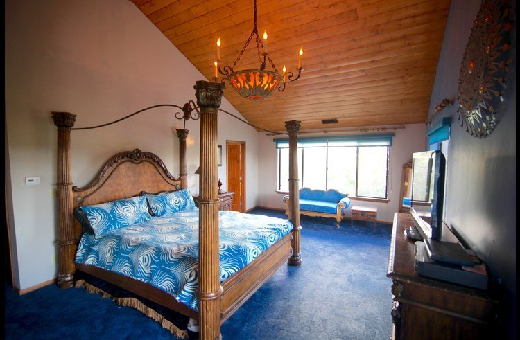 Vaulted ceilings and chandelier in the master suite