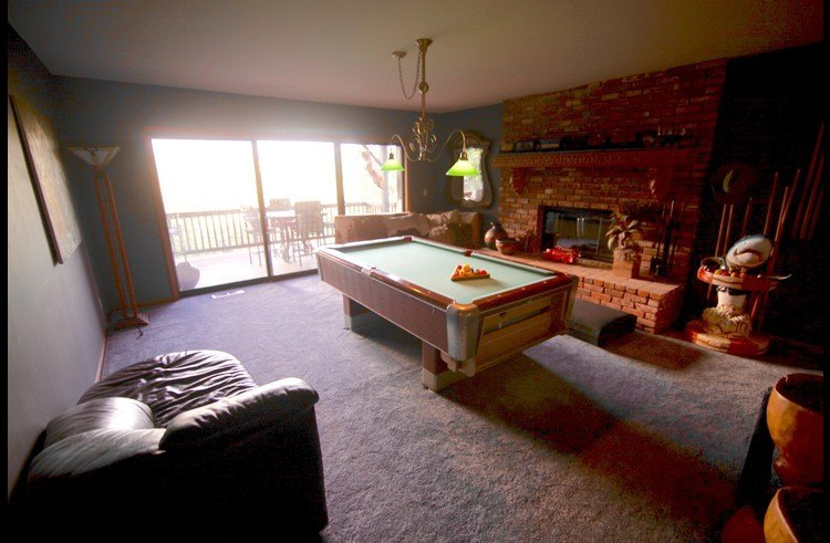 Game room with access to the deck