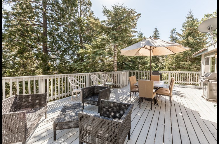 Large deck with patio furniture to enjoy the outdoors!
