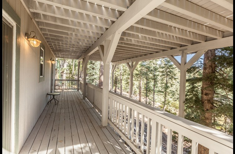 Lower level deck with views of the forest