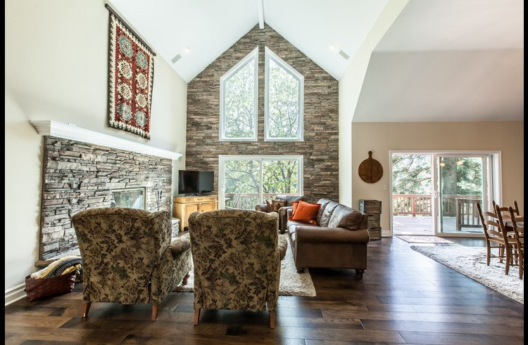 Living room with vaulted ceilings and extensive use of custom stone