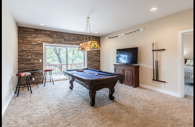 Game room on lower level with pool table and flat screen TV