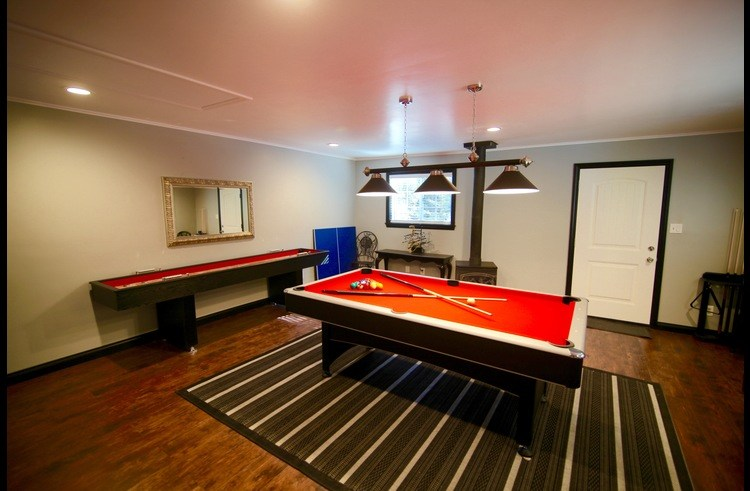 Pool table with shuffle board behind it