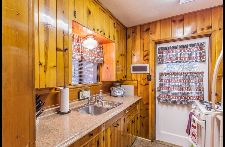 Kitchen with knotty pine cabinets