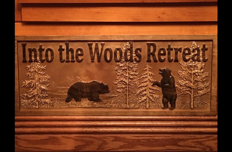 Into the Woods Retreat custom carved sign