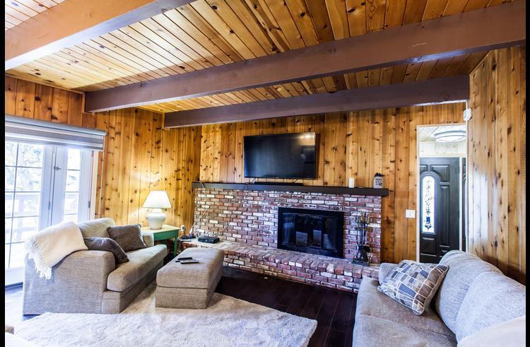 Family room on lower level with fireplace and 60 inch flat screen TV