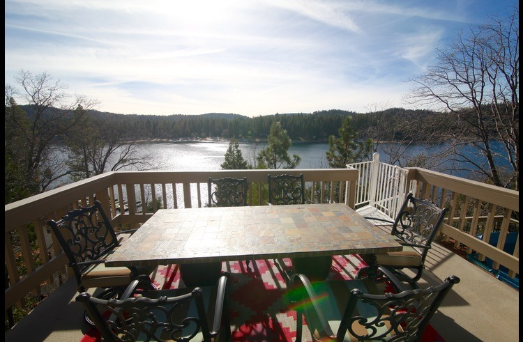 Panoramic lake views from the outdoor dining table