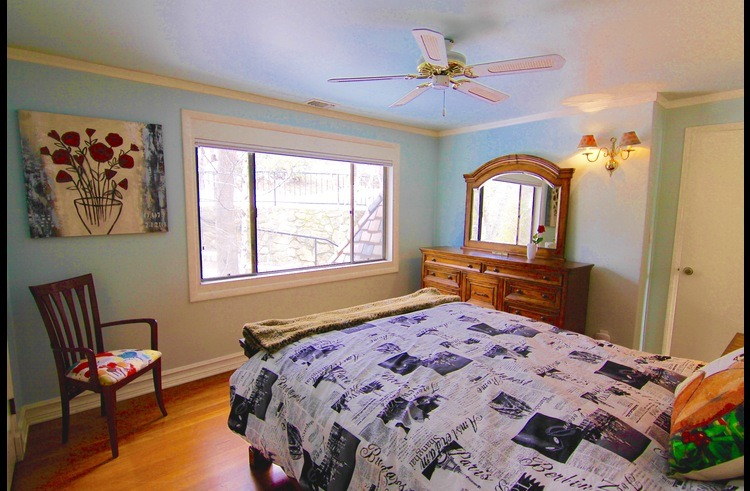 Guest room on upper level with queen bed