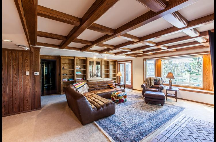 Family room with picture windows and custom ceiling beams