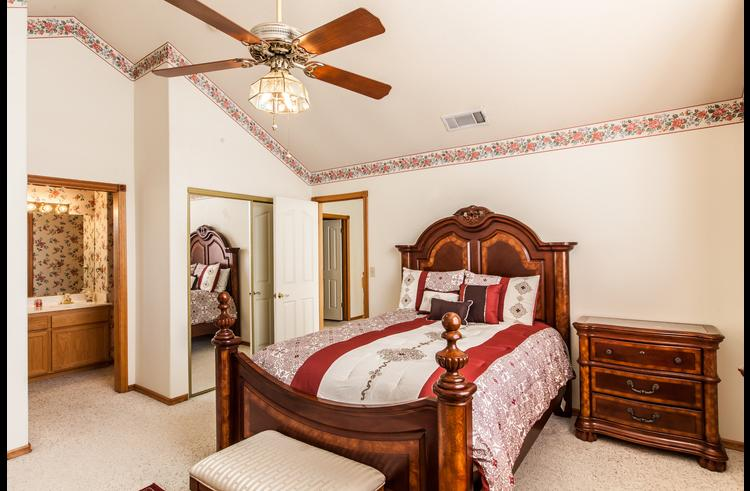 Master bedroom on upper level with queen size bed