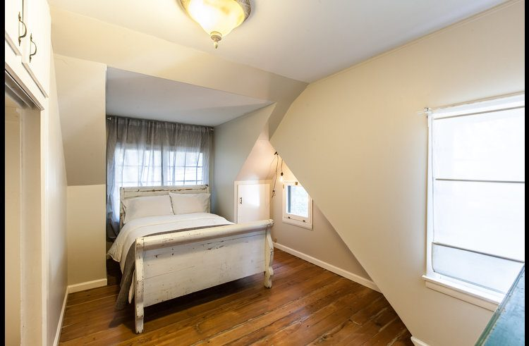 Guest room 4 on upper level with queen sleigh bed