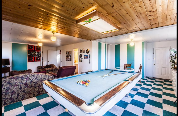 Game room with pool table and two full size sofa beds