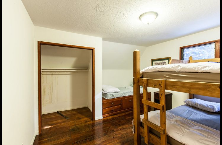 Guest room 5 with full size bunk bed and twin platform bed