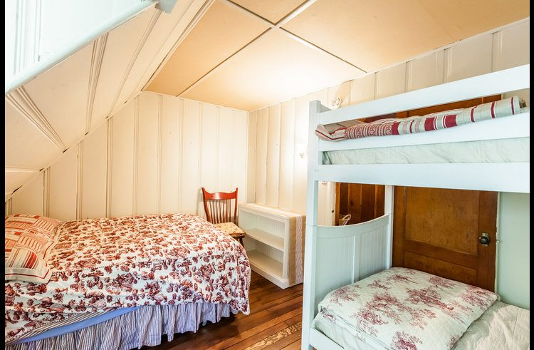 Guest room 1 with queen bed and twin size bunk bed