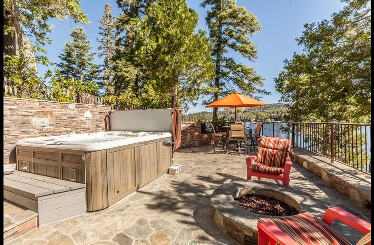 Lower level deck with hot tub and sitting area with amazing views