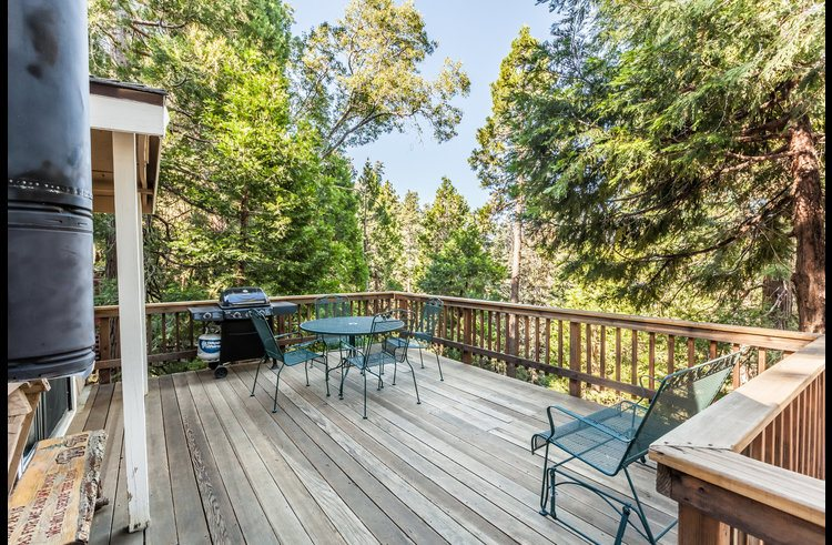 Nice deck with patio furniture and great views of the surrounding trees