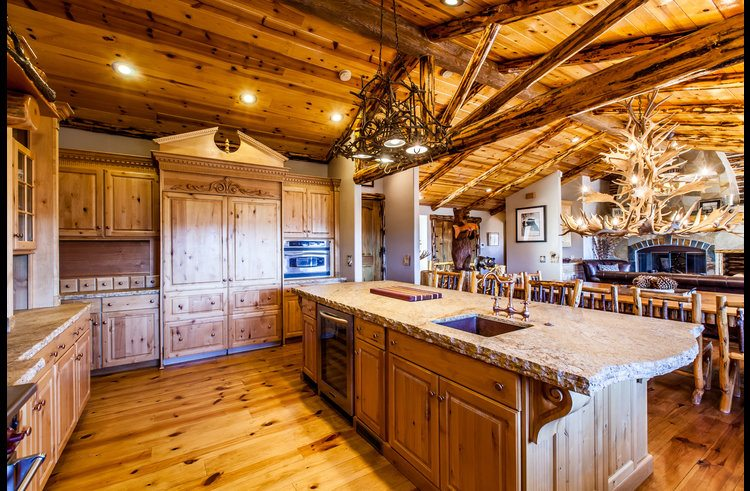 Custom rustic wood cabinets and subzero refrigerator