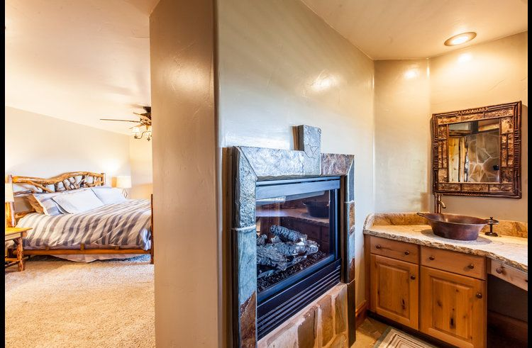 Gas fireplace open on both sides of master bedroom and attached master bath