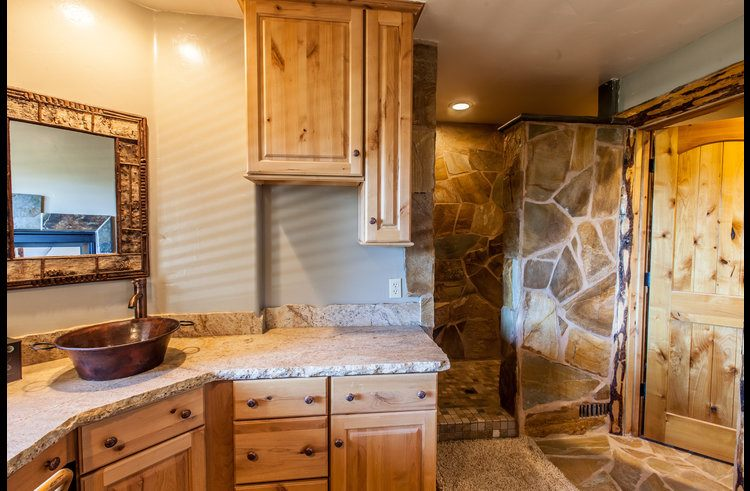 Master bathroom with custom stone shower